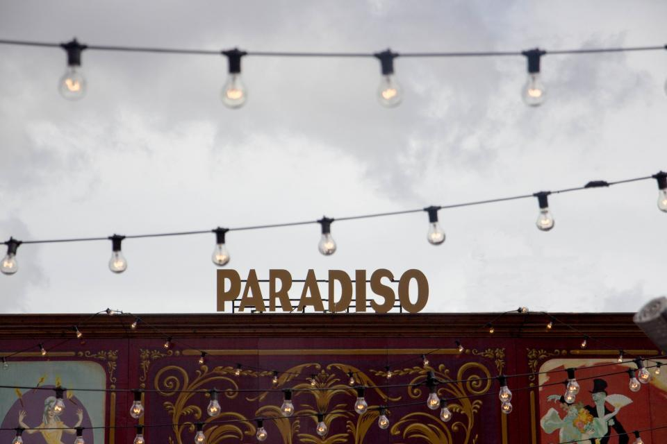 still signage paradiso themed park coach trailer design bulbs lantern sky clouds