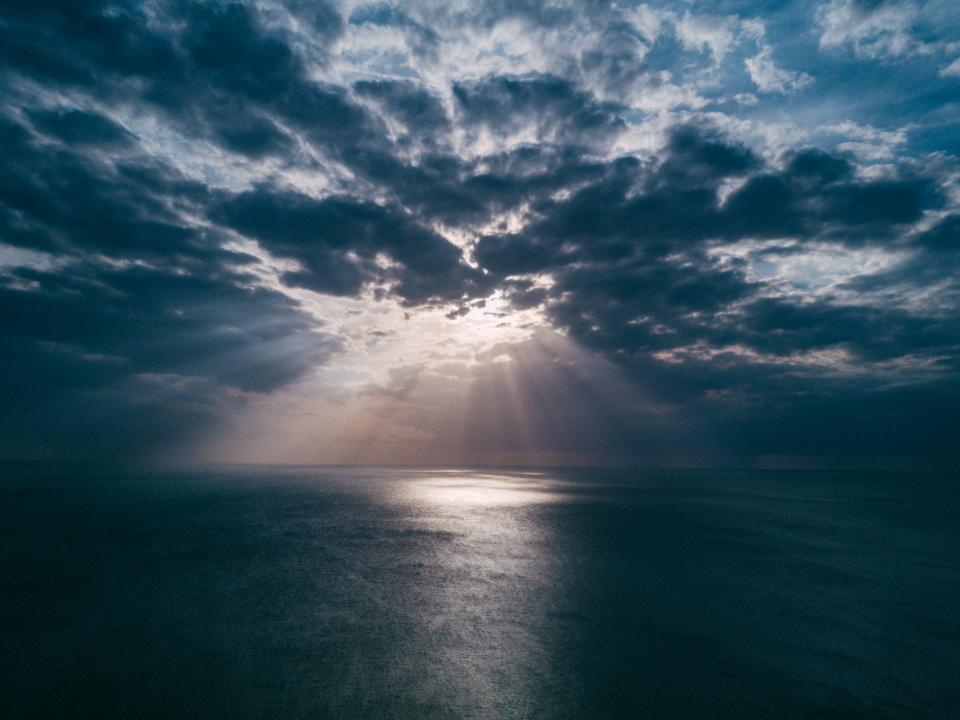sea ocean water waves nature cloudy sky clouds horizon sunlight