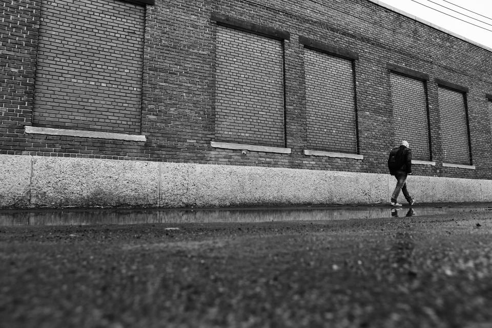 industrial building bricks warehouse man guy walking people city black and white lifestyle