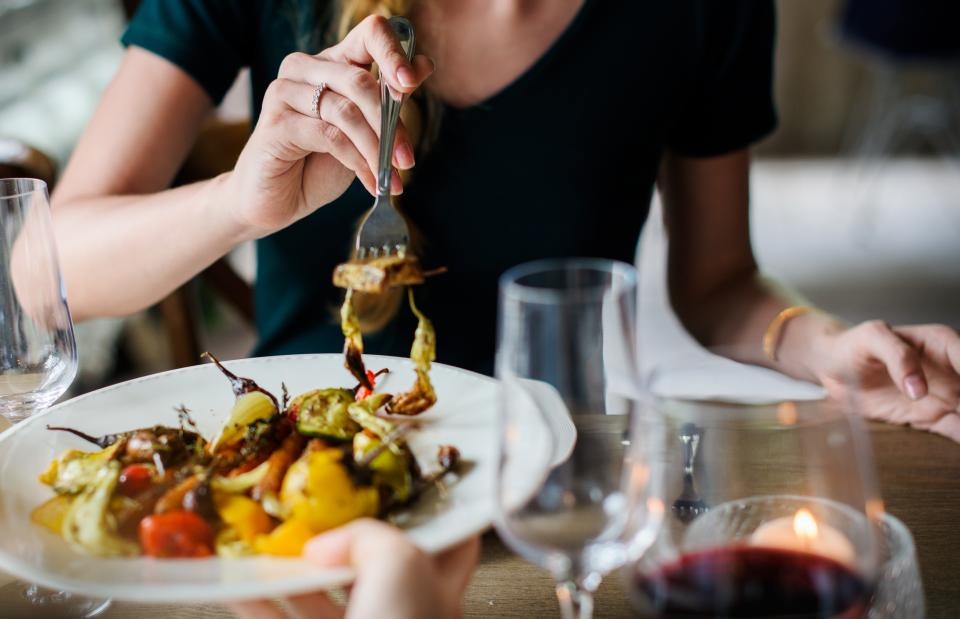 people girl woman eating food dish viand restaurant dinner date delicious cuisine candle light wine glass