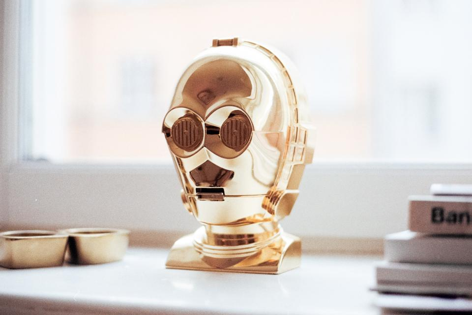 robot gold decoration art table house home design books window reflection shiny