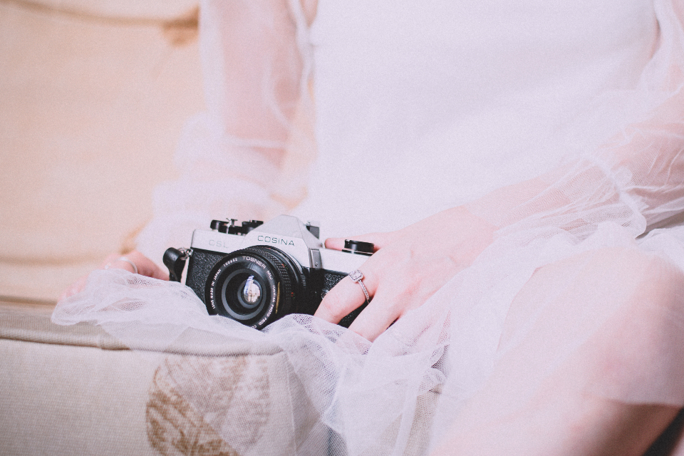 bride camera photographer photography vintage lens retro white dress wedding sitting girl female woman