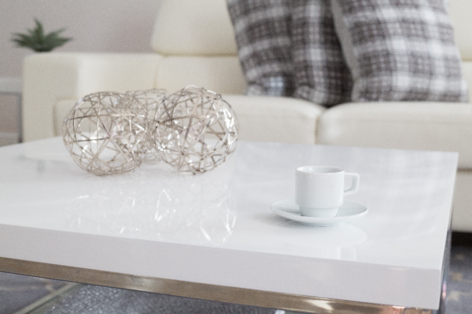 coffee table interior design cup mug living room couch sofa pillows decor decoration furniture home