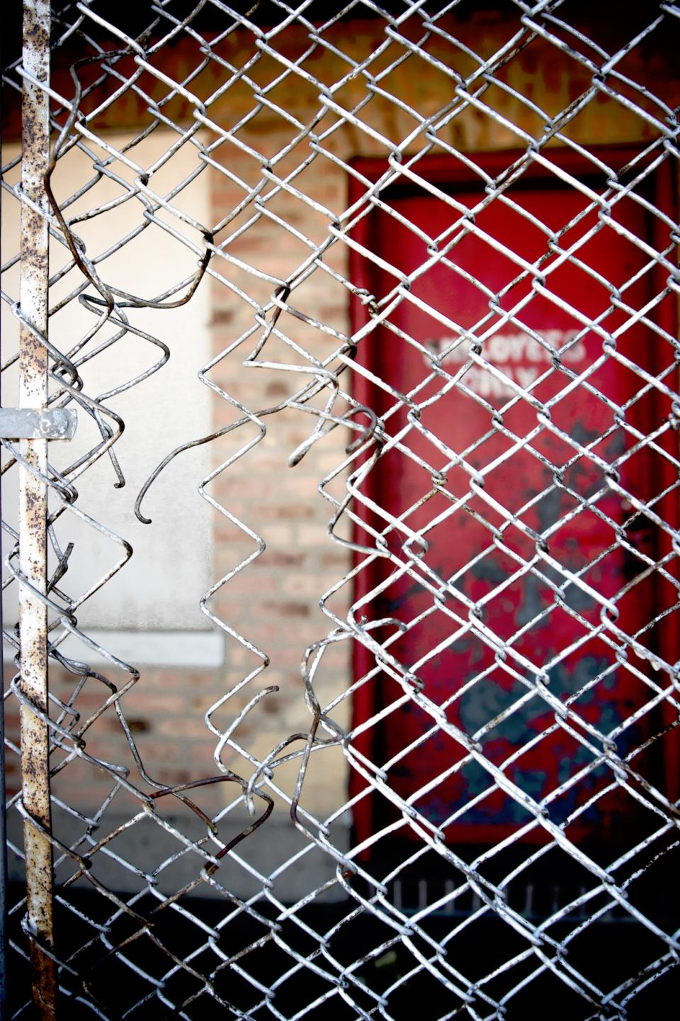 chicken wire fence door red sign