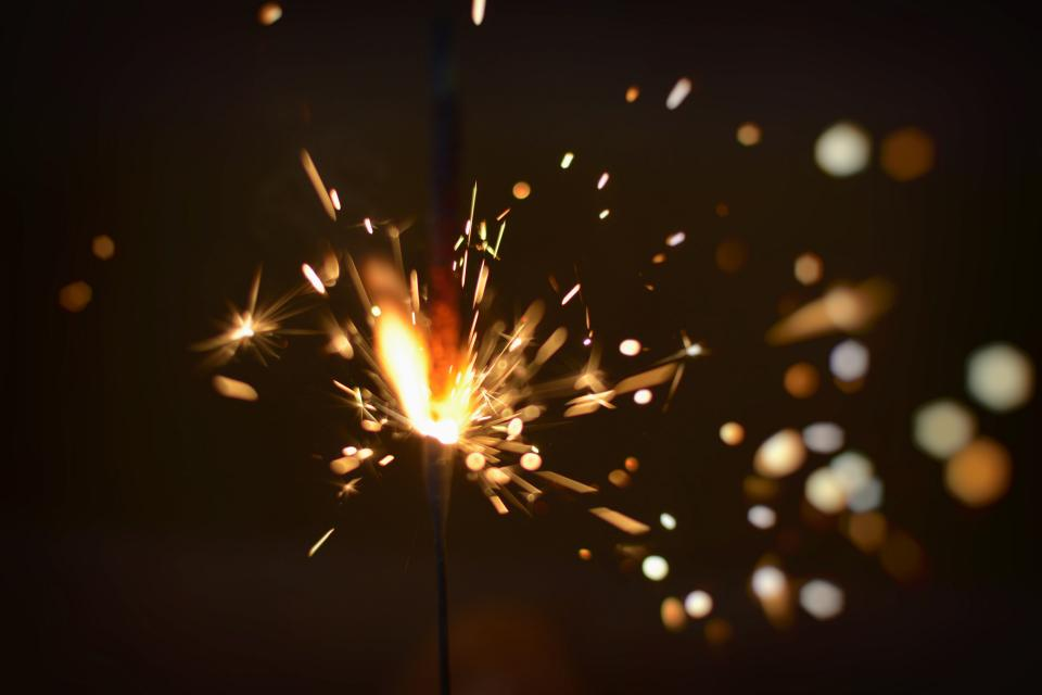 sparks sparkler light party celebration birthday fire flame dark night evening bokeh