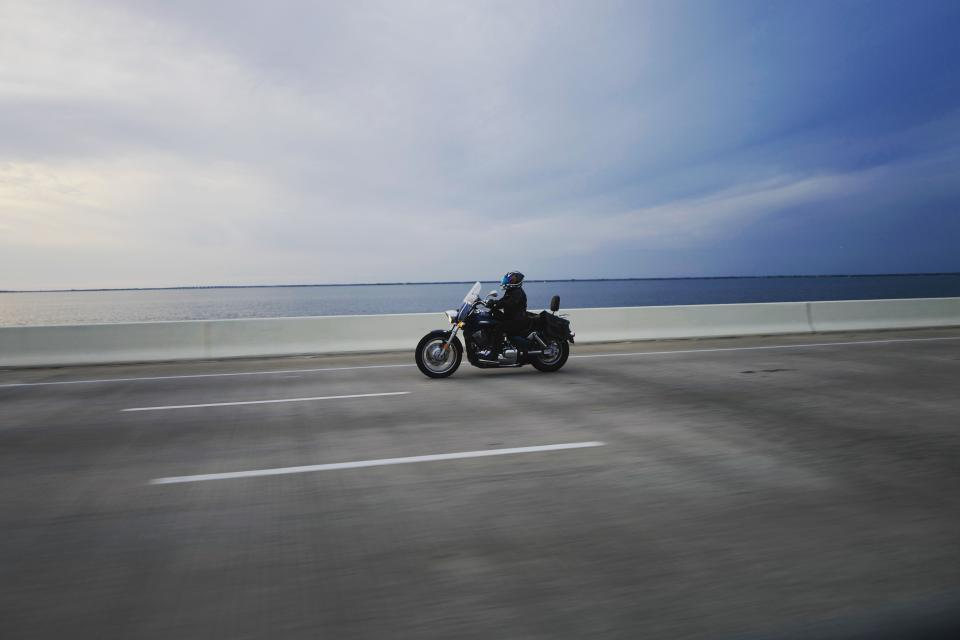 horizon people riding driving motorcycle motorbike travel road trip sea ocean water blue sky clouds