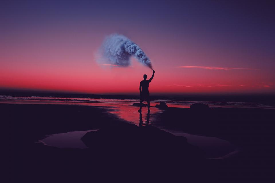 sea ocean water waves nature sand people man alone smoke silhouette clouds sky sunset