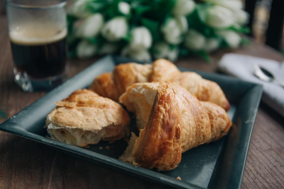 bread food croissant breakfast snack black coffee drink blur flower plate