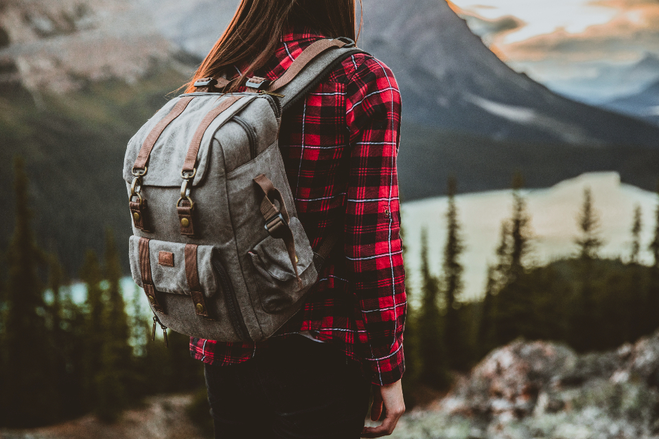 girl brunette backpack backpacking traveler travelling travel explorer exploring explore adventurer adventure lake forest trees nature earth mountains mountain photographer