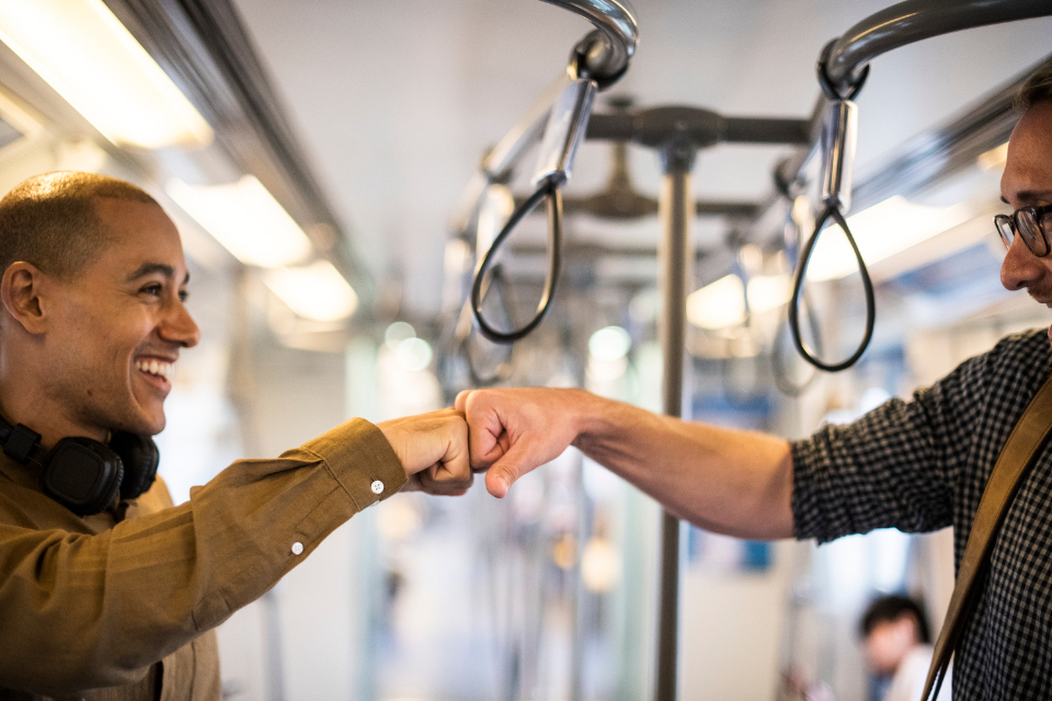 achievement after work bump caucasian cheerful colleagues communication cooperation deal european expression fist fist bump friends friendship gesture greeting group hands happiness help man meeting partners partnership peopl