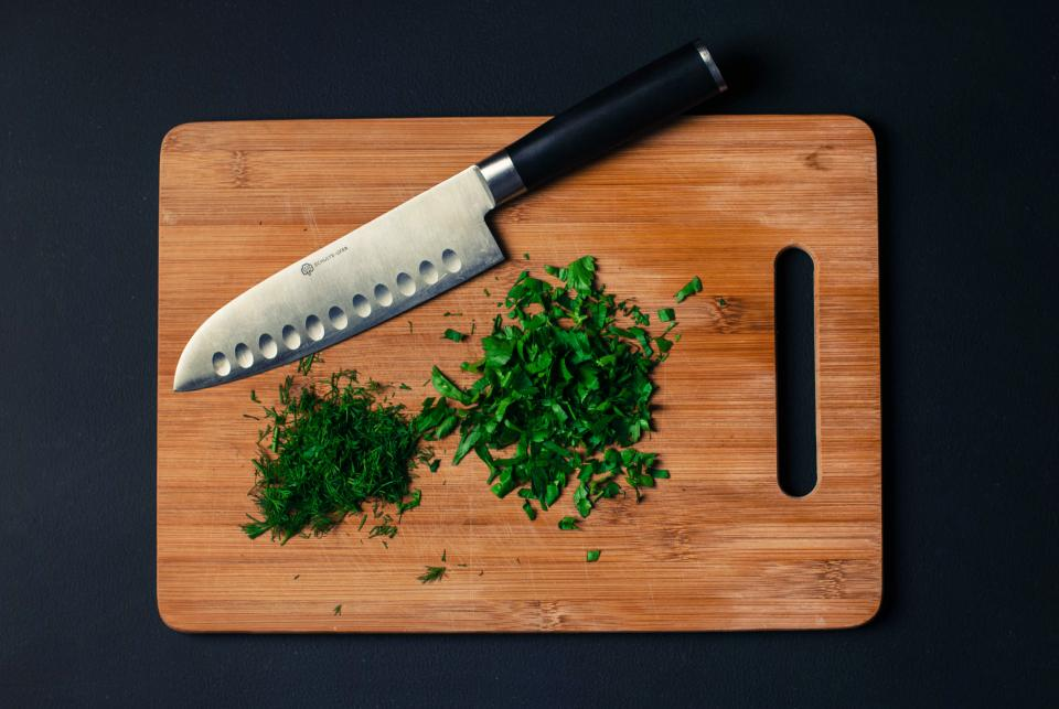 cutting board knife chopped parsley dill ingredients food healthy chef kitchen