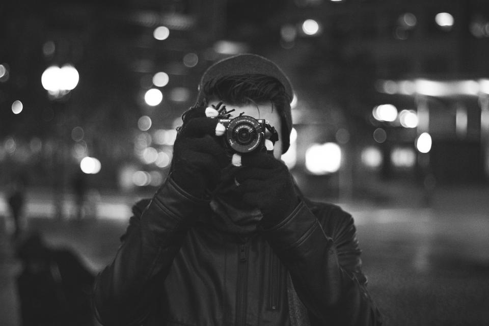 people man photographer photography camera lens picture photo black and white monochrome lights bokeh urban city