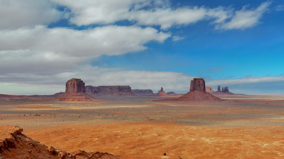 monument valley landscape view horizon blue sky clouds park desert