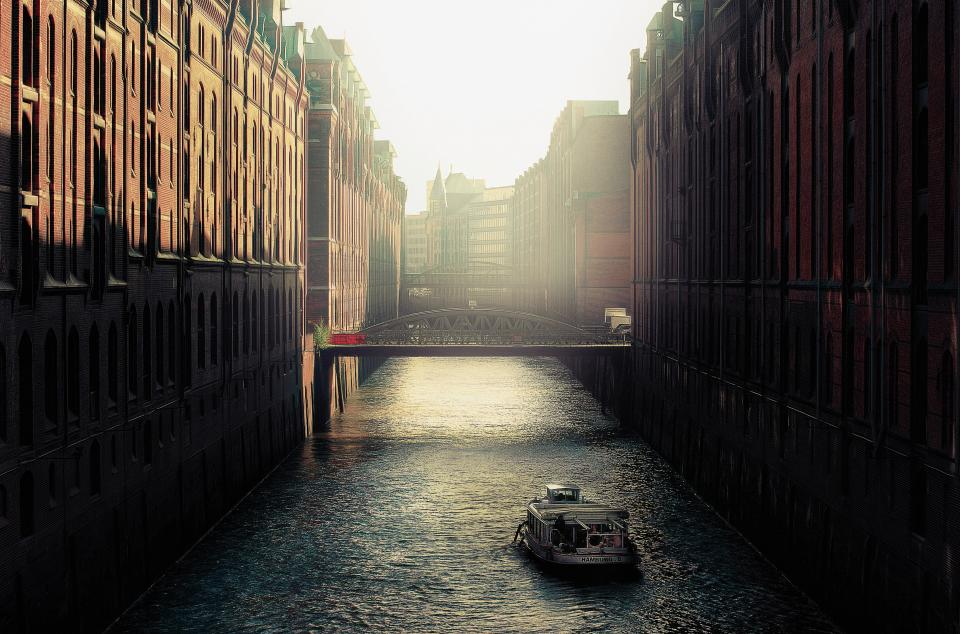 boat canal water bridge buildings city architecture sunset