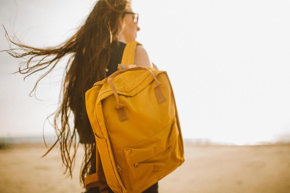 yellow backpack bag people girl woman travel outdoor