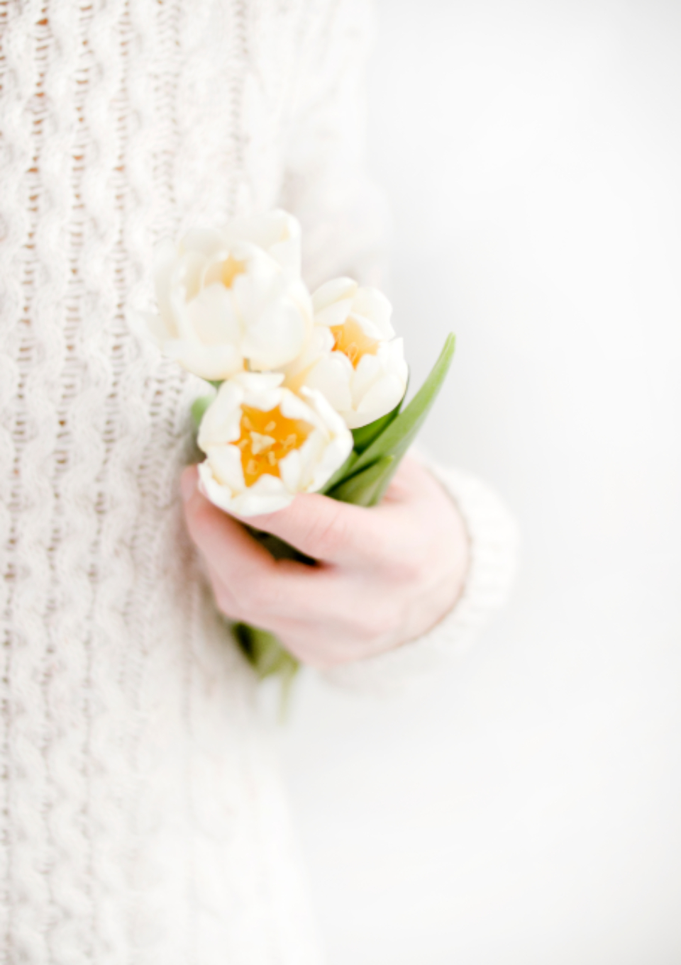 woman holding white flowers nature fauna people female girl yellow hand hold close up