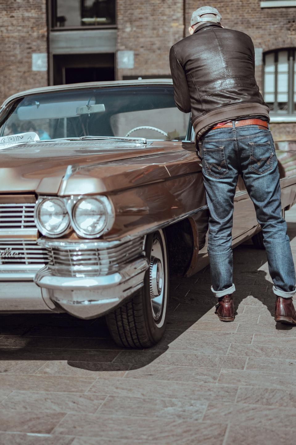 vintage car travel brown people man guy jeans leather jacket sunny day