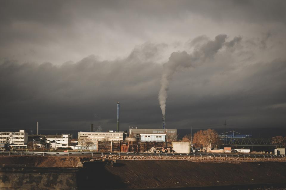 architecture building infrastructure chimney smoke plant clouds sky