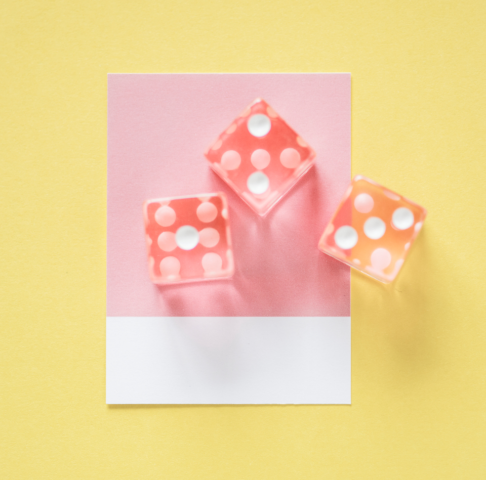 art background card close up colorful concepts creativity cube dice gambling game isolated lay flat maths micro object orange paper pastel pink three top view toy white yellow
