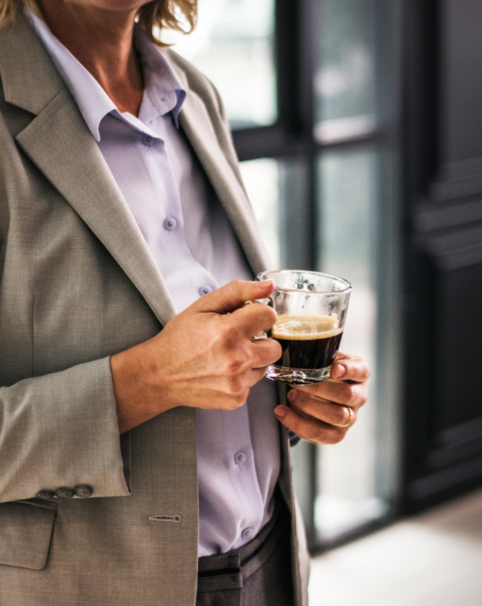 blazer boss break break time breakfast business businesswoman cafe casually caucasian ceo closeup coffee coffee break coffee cup coffee shop company corporate cup cup of coffee drink drinking enjoy european exe