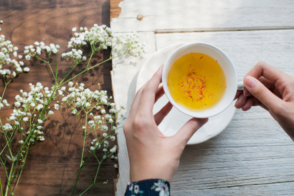 beverage cafe closeup cup daily drink drinking enjoying flower hand healthy herb herbal hot drink lifestyle menu morning mug organic peaceful person refreshing relax routine rustic saffron tea texture