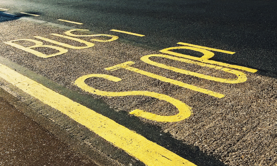 road bus stop road road sign street streets stop bus