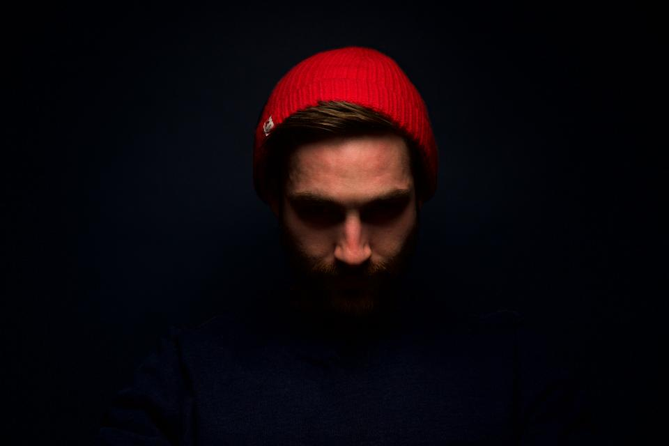 people man guy face red beanie dark