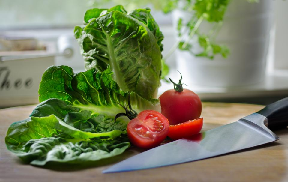 salad lettuce tomatoes vegetables knife cutting board kitchen food healthy