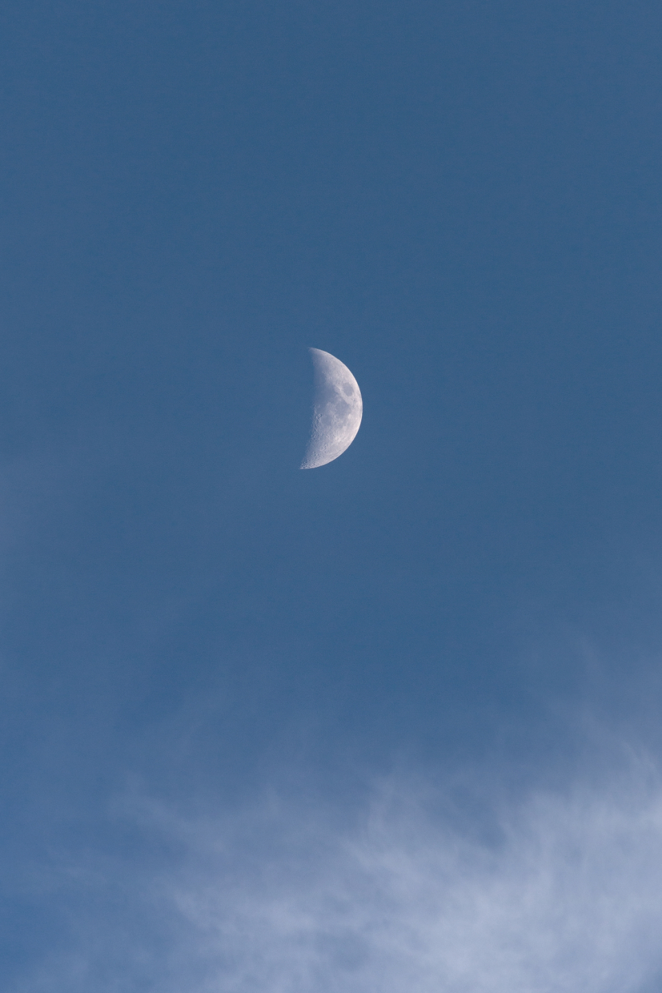 moon blue sky clouds daytime nature outdoors space lunar atmosphere crater half tranquil