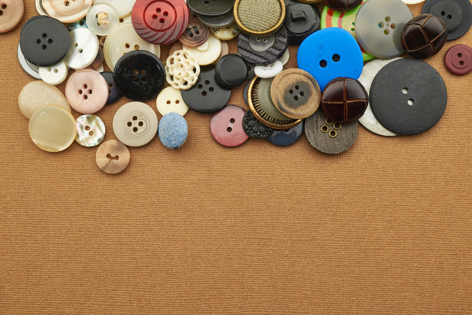 sewing buttons background assortment variety clothes craft shapes circle texture flat lay copyspace various fashion