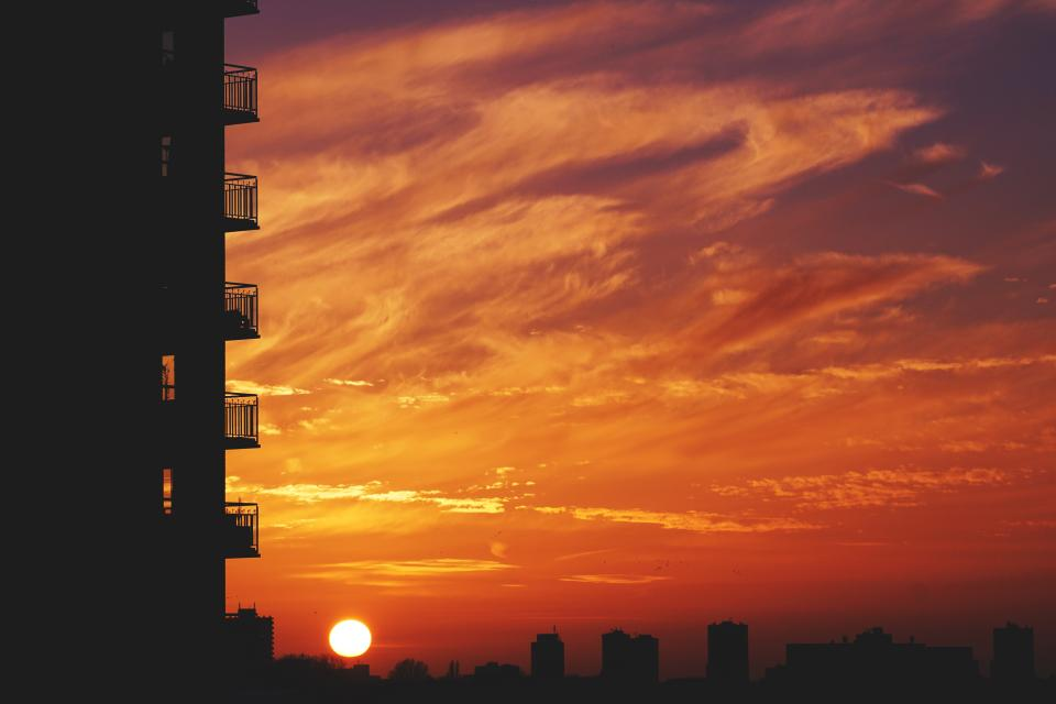architecture building infrastructure sunset silhouette skyline city clouds sky