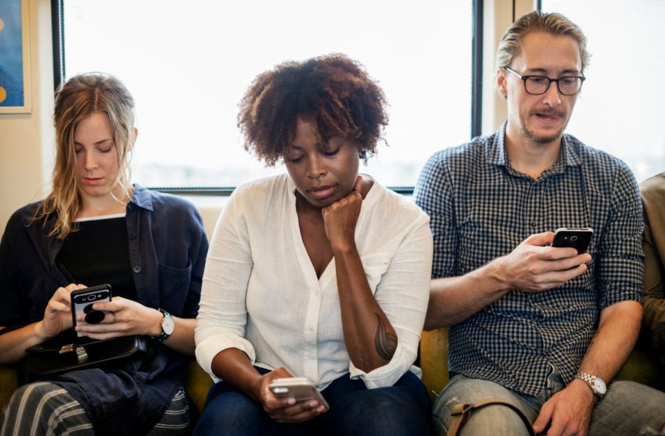 african american caucasian cellphone chat chatting communication community commuter connecting connection data device digital electronic european friends gadget global information innovation internet man media message messaging mobile network net