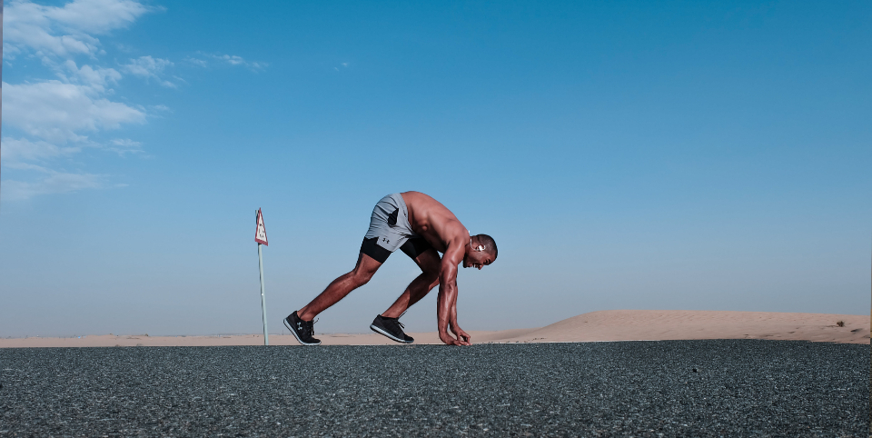 man ready run fast speed takeoff black fitness healthy blue sky cloud desert concrete road running fit