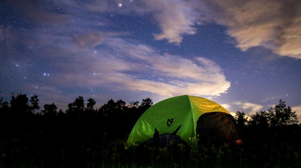 night tent camping woods forest star galaxy space clouds sky dark trees grass