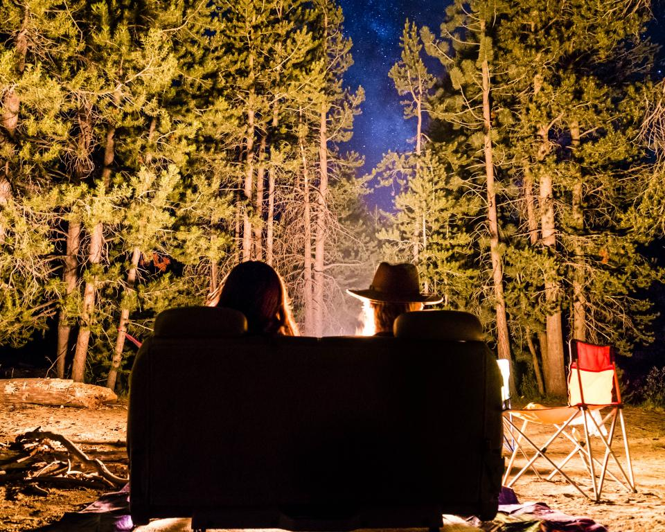 people friends date night bonfire couch green trees plant nature camping travel outdoor