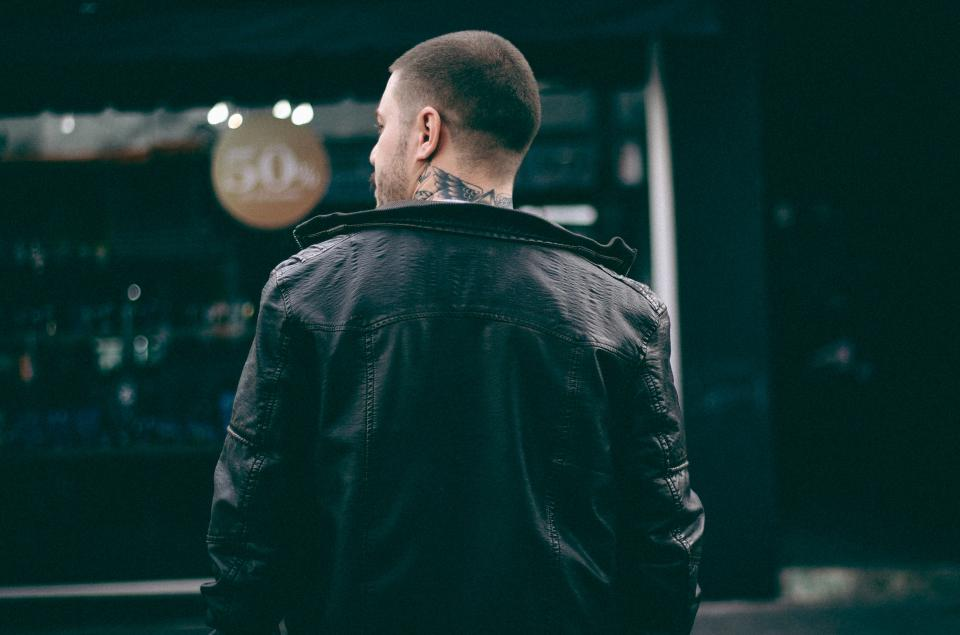 guy man back black jacket tattoo leather bokeh city street urban fashion establishment sale