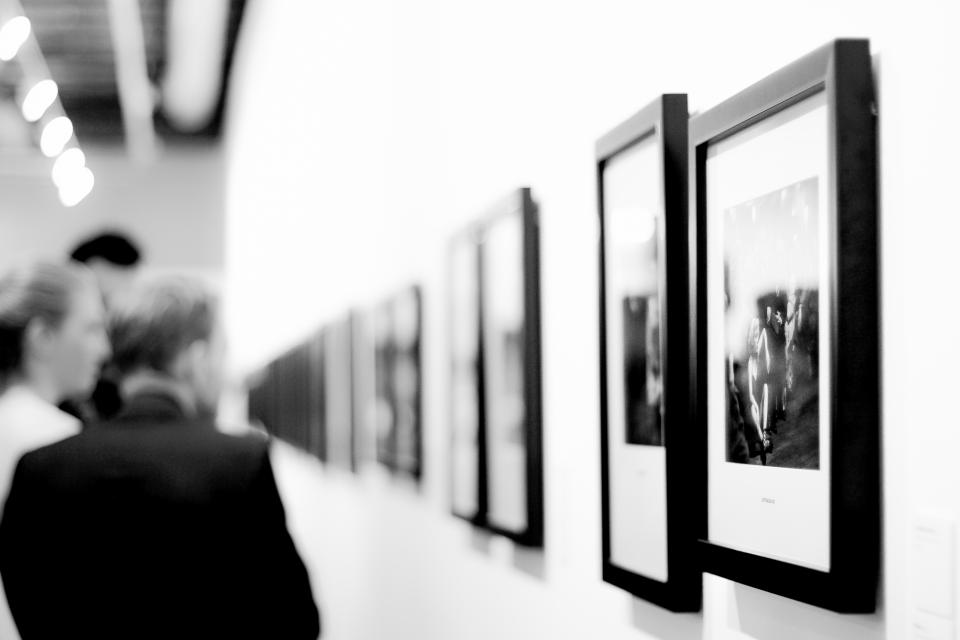 black and white photos frame wall people museum art