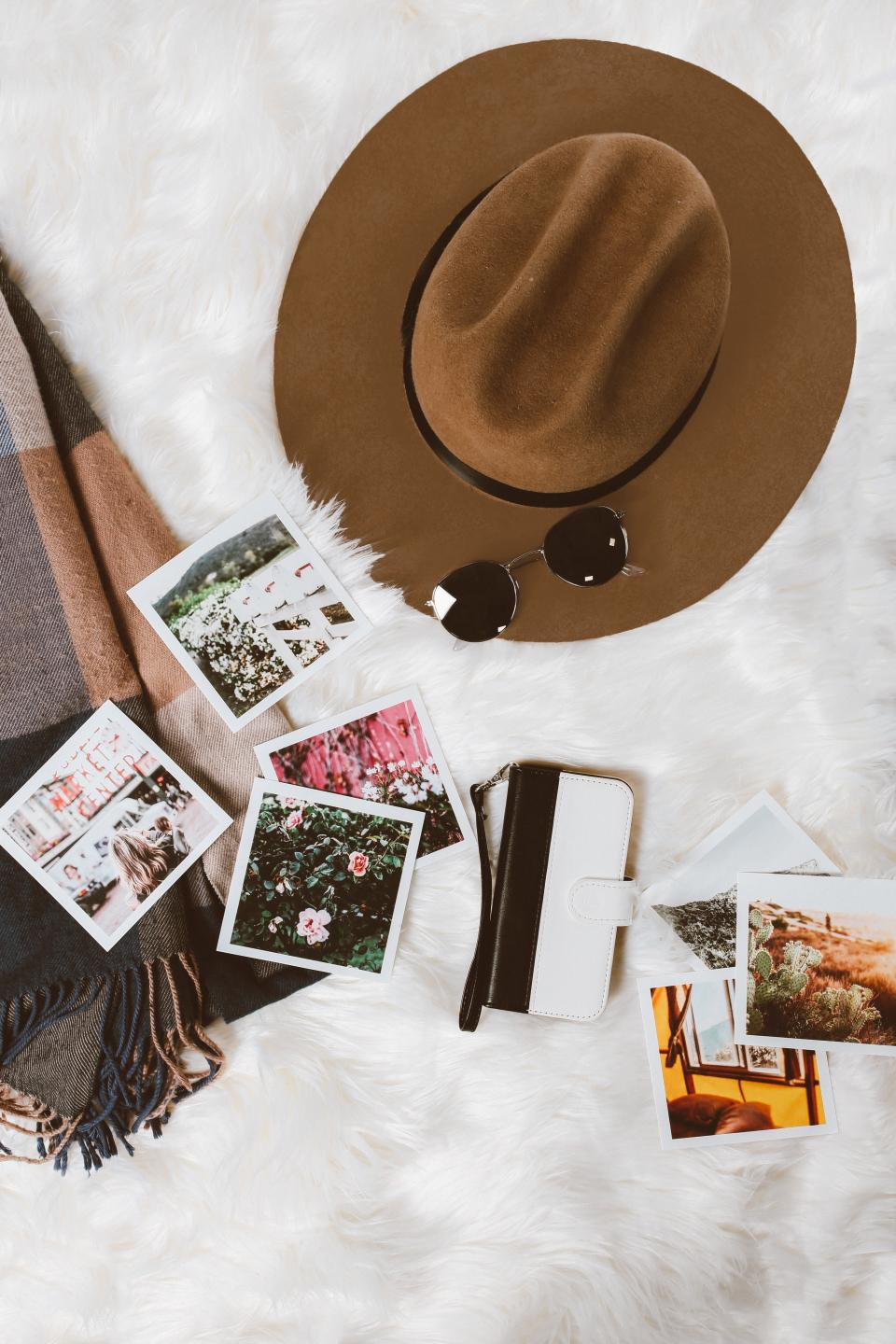shawl hat sunglasses photo wallet travel
