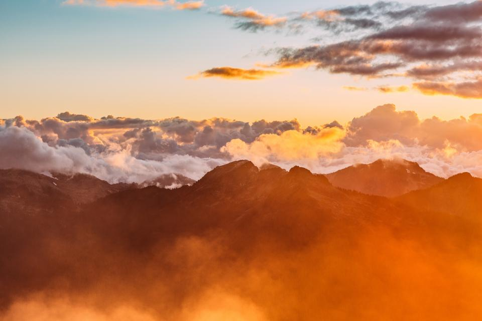 mountains peaks summit sunset sky clouds landscape nature aerial view