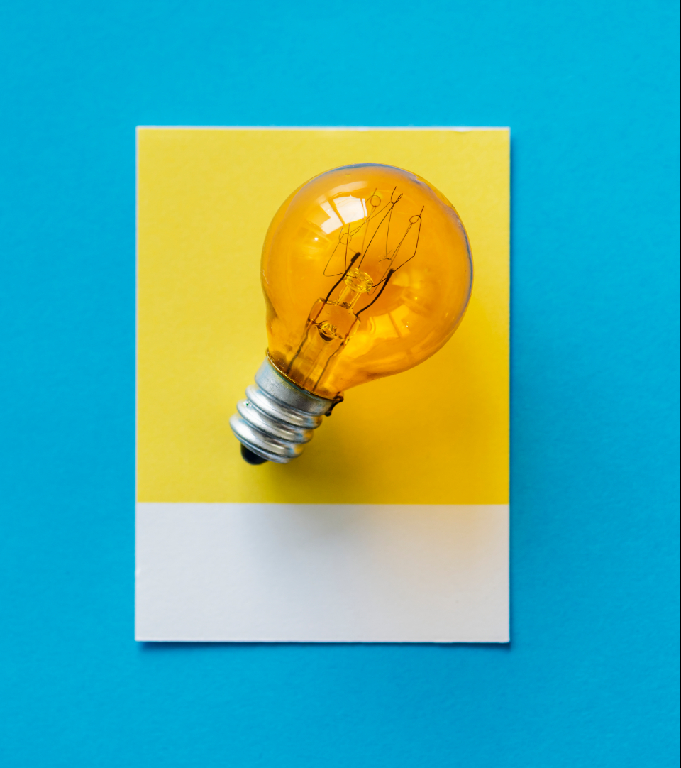blue bulb card colorful concept conceptual creative creativity design electric electrical electricity energy glass glowing heat idea image innovation inspiration invention isolated light light bulb object orange paper power solution symbol