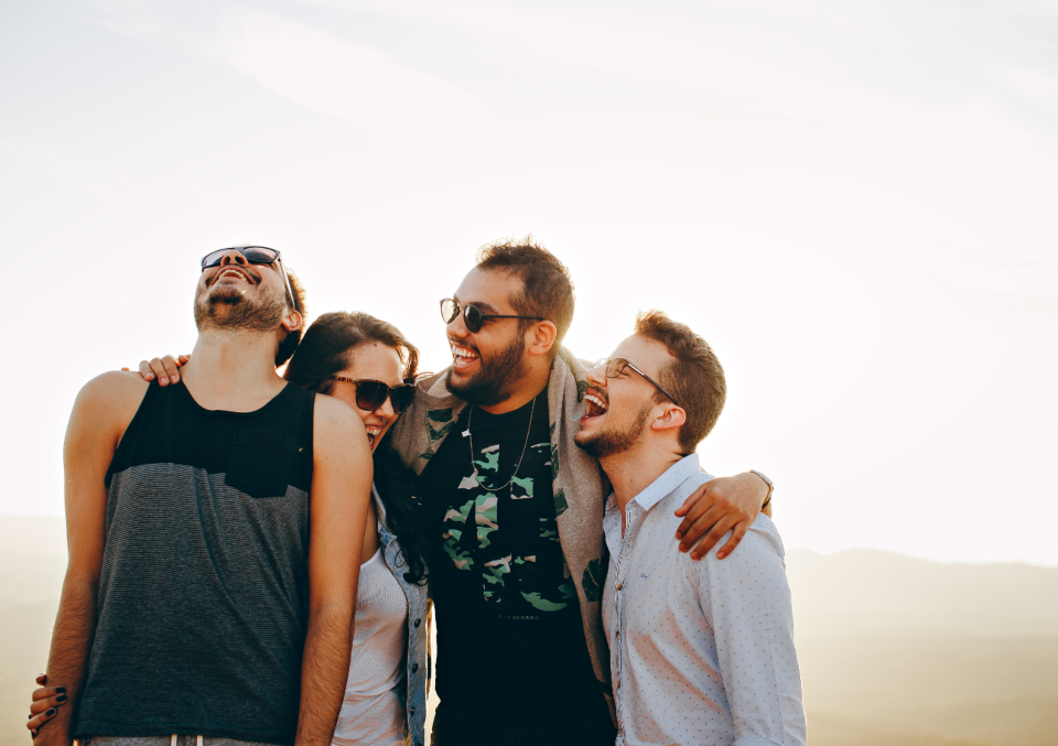 group friends laughing people man woman male female sunglasses happy sunset
