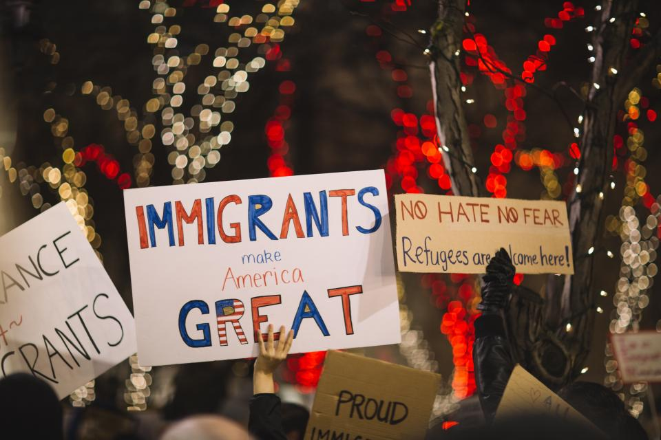 posters people rally protest immigrants us america human ights night bokeh lights unite trump