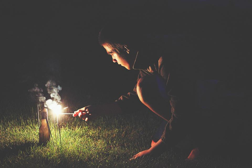 nature landscape green grass light fire spark people man dark night bottle outdoor