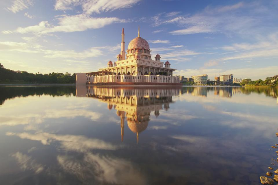 building lake reflection architecture infrastructure trees view mosque sky clouds