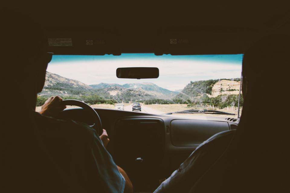 people couple girl man drive ride car vehicle road trip travel mountain sky clouds
