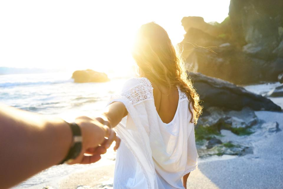 sea ocean water waves nature coast beach shore rock cliff clouds sky sunlight sunrise people girl holding hand man watch