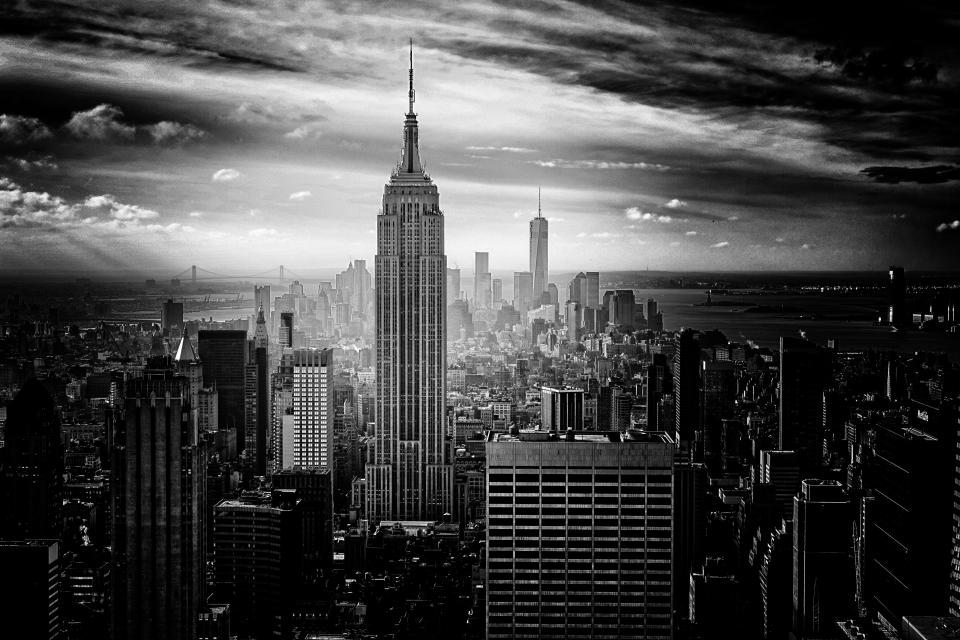 New York city Empire State buildings downtown towers high rises architecture sky clouds black and white urban