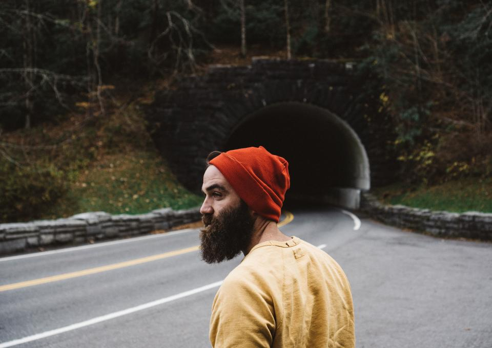 road path green grass trees plants nature tunnel dark people man alone beards