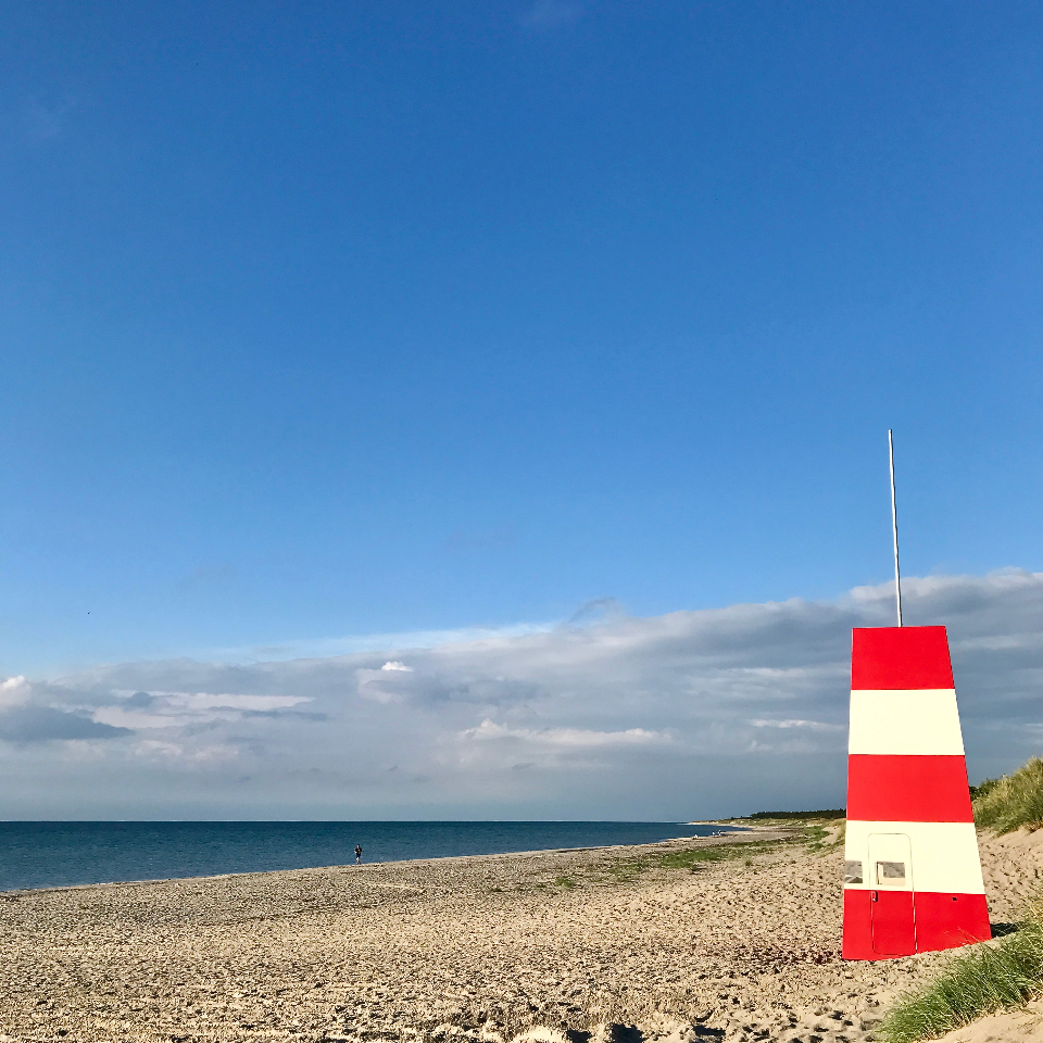 Denmark Denemarken Beach blue sky clouds clear sand stone rock sea water ocean