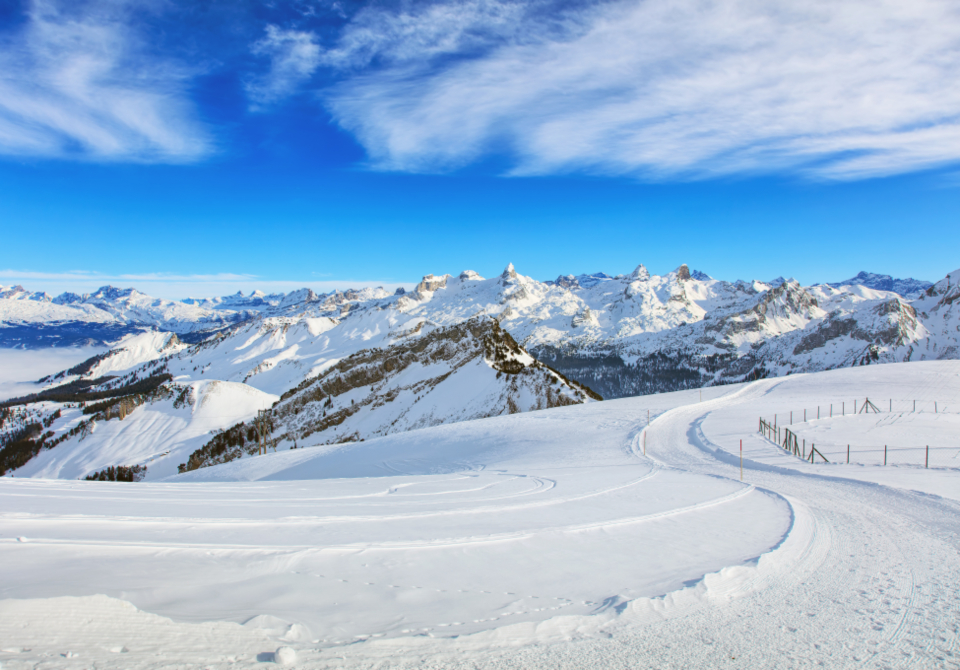 summit peak cliff slope travel travel destination Swiss Alps Alps alpine landscape nature Fronalpstock mountain Schwyz Swiss Europe European winter wintertime snow white blue sky Switzerland view cloud ski slope piste